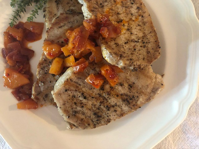 Brined pork chops with pineapple and Calabria chili relish